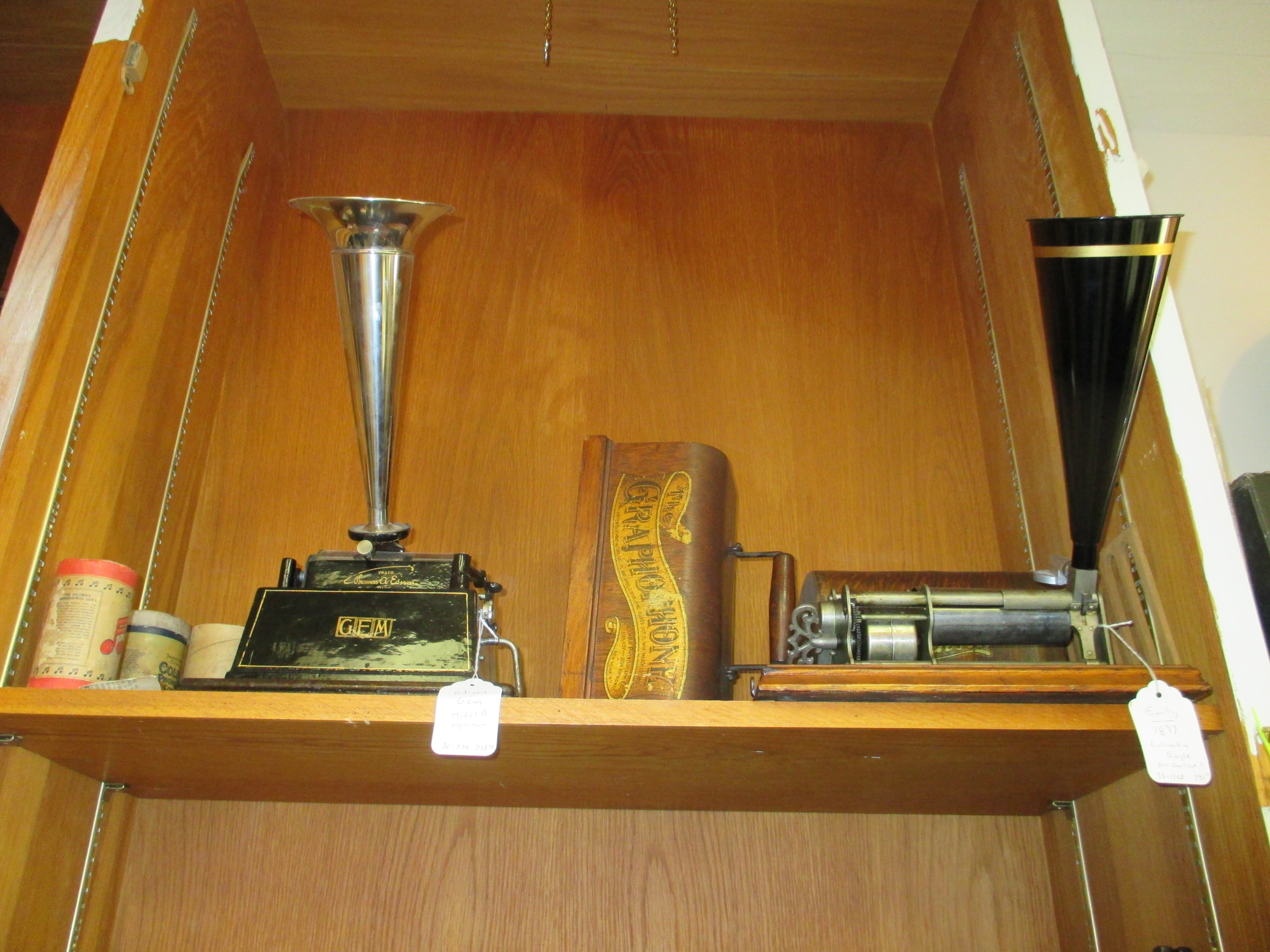 Left, Edison Gem Phonograph Model B c1905 - crank type $795. Right, Columbia Eagle Phonograph 1897 $795